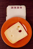 Ceramic dish with cheese Royalty Free Stock Image