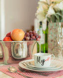 Ceramic dish cup set on dining table Stock Photo