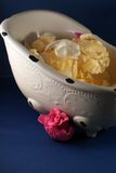 Ceramic dish and flower petals Royalty Free Stock Photo