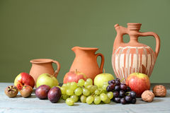 : Ceramic dishes and fresh fruit Stock Photos