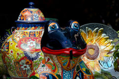 Ceramic dishes and frog at market in Old Town Royalty Free Stock Photos