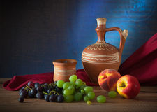 Ceramic dishes and fruit Stock Image