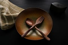 Ceramic dishplate and wooden spoon,wooden fork Stock Images