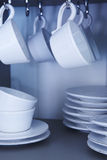 Ceramic dishware. Cups and plates vertical blue tone stock photos