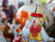 Ceramic dol lclown. Desk at the flea market: traditional russian handmade ceramic doll clown Stock Image