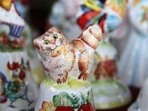 Ceramic doll cat. Desk at the flea market: traditional russian handmade ceramic doll cat Stock Images