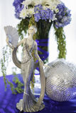Ceramic doll and flower bouquet Stock Images