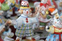 Ceramic doll horn. Desk at the flea market: traditional russian handmade ceramic doll man playing horn Royalty Free Stock Photos
