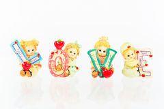 Ceramic Doll love. On a white background Royalty Free Stock Images