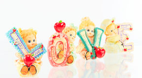 Ceramic Doll love. On a white background Stock Photography