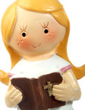 Ceramic doll praying. Reading a book. Isolated on white Stock Photo