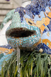 Ceramic dragon fountain in Parc Guell - park city designed by Antoni Gaudi. Royalty Free Stock Photo