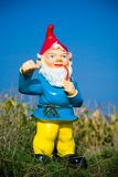 Ceramic dwarf outdoors. Ceramic dwarf standing outside in the corn field Stock Image
