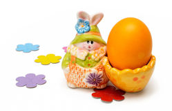 Ceramic easter hare. Easter hare with colored egg Stock Image