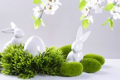 Ceramic easter rabbits and egg. On a grey background Royalty Free Stock Images
