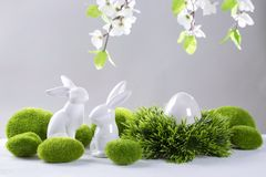 Ceramic easter rabbits and egg. On a grey background Royalty Free Stock Photos
