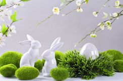 Ceramic easter rabbits and egg. On a grey background royalty free stock photo