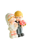 Ceramic figures of married couple. Ceramic figures of children dressed as a bride and groom. Isolated on white background Stock Photos