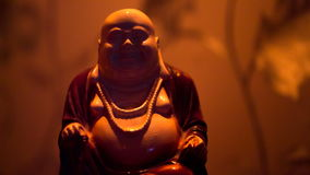 Ceramic figurine of fat bald Jolly Buddha stock video
