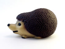 Ceramic figurine hedgehog. Beautiful ceramic figurine hedgehog on white background Royalty Free Stock Photo