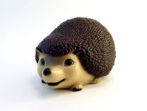 Ceramic figurine hedgehog. Beautiful ceramic figurine hedgehog on white background Stock Image