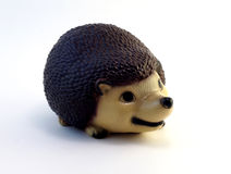 Ceramic figurine hedgehog. Beautiful ceramic figurine hedgehog on white background Stock Photos