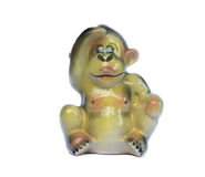 Ceramic figurine. Of a monkey on a white background Royalty Free Stock Images