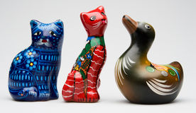 Ceramic figurines. A row of three ceramic animals stock photos