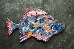 Ceramic Fish on slate. A Ceramic fish on a slate background Stock Photos