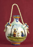 Ceramic  flask. Holy family decoration on ceramic flask Royalty Free Stock Images