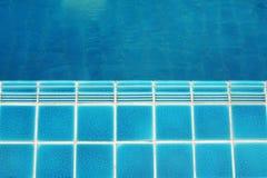 Ceramic  floor beside the blue swimming pool Stock Photo