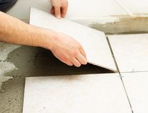 Ceramic Floor Tile Application Royalty Free Stock Photos