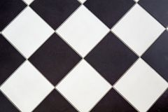 Ceramic floor tile black and white. Cross checker board pattern background stock image