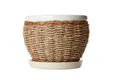 Ceramic flowerpot with braided from twig Stock Image