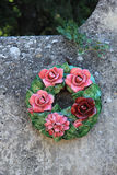 Ceramic flowers funeral wreath. Funeral wreath with ceramic flowers at a French cemetery royalty free stock photos