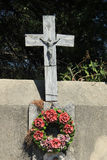 Ceramic flowers funeral wreath. Funeral wreath with ceramic flowers at a French cemetery stock photos