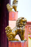 Ceramic Foo Lion Statues. On Posts Outside Chinese Temple royalty free stock image