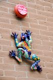 Ceramic gecko on a wall Stock Images