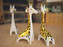 Ceramic giraffe figurine. Depth of field Royalty Free Stock Images