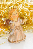 Ceramic girl-angel with golden tinsel . Stock Photo