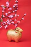 Ceramic goat souvenir on red paper,Chinese calligraphy. Royalty Free Stock Images