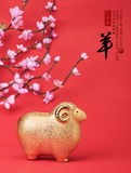 Ceramic goat souvenir on red paper,Chinese calligraphy. Royalty Free Stock Photos
