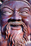 Ceramic god face. Chinese ceramic sculpture ,the face of mammon god Royalty Free Stock Photo