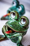 Ceramic green frogs, toys Royalty Free Stock Image
