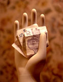Ceramic hand with money Royalty Free Stock Photos