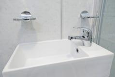 Ceramic hand wash basin. Modern ceramic hand wash basin in a rectangular shape Royalty Free Stock Images