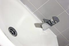 Ceramic hand wash basin. Bathroom: detail of a modern ceramic hand wash basin Royalty Free Stock Photo
