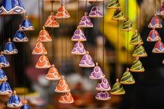 Ceramic hanging bells in the handicraft mart Kaziukas, Vilnius, Lithuania Royalty Free Stock Photo