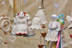 Ceramic hanging bells in the handicraft mart Kaziukas, Vilnius, Lithuania Royalty Free Stock Images