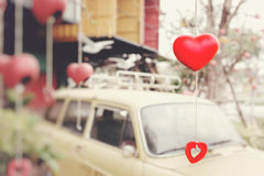 Ceramic hearts hanging in the trees. The background is a blur of Royalty Free Stock Photos